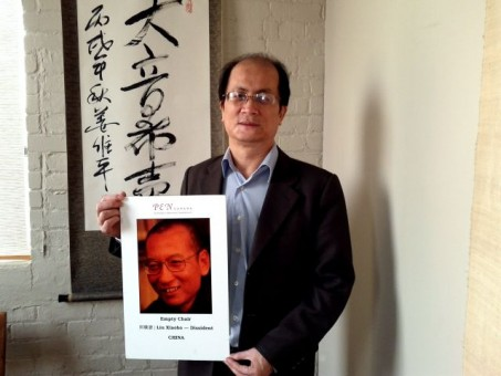 Weiping holds Empty Chair of Liu Xiaobo