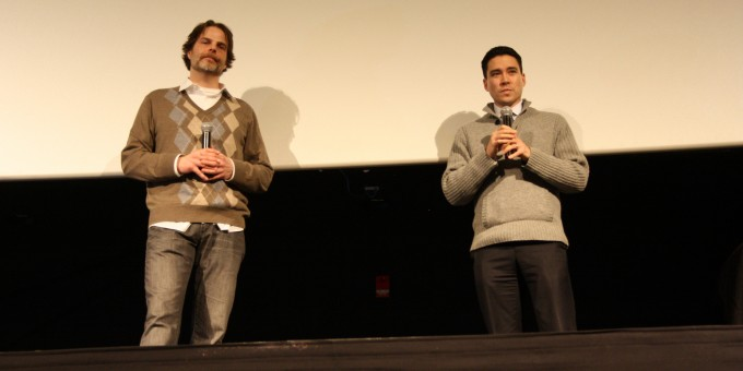 Hot Docs programmer Robin Smith stands on stage with Chris Hope as they take audience questions.
