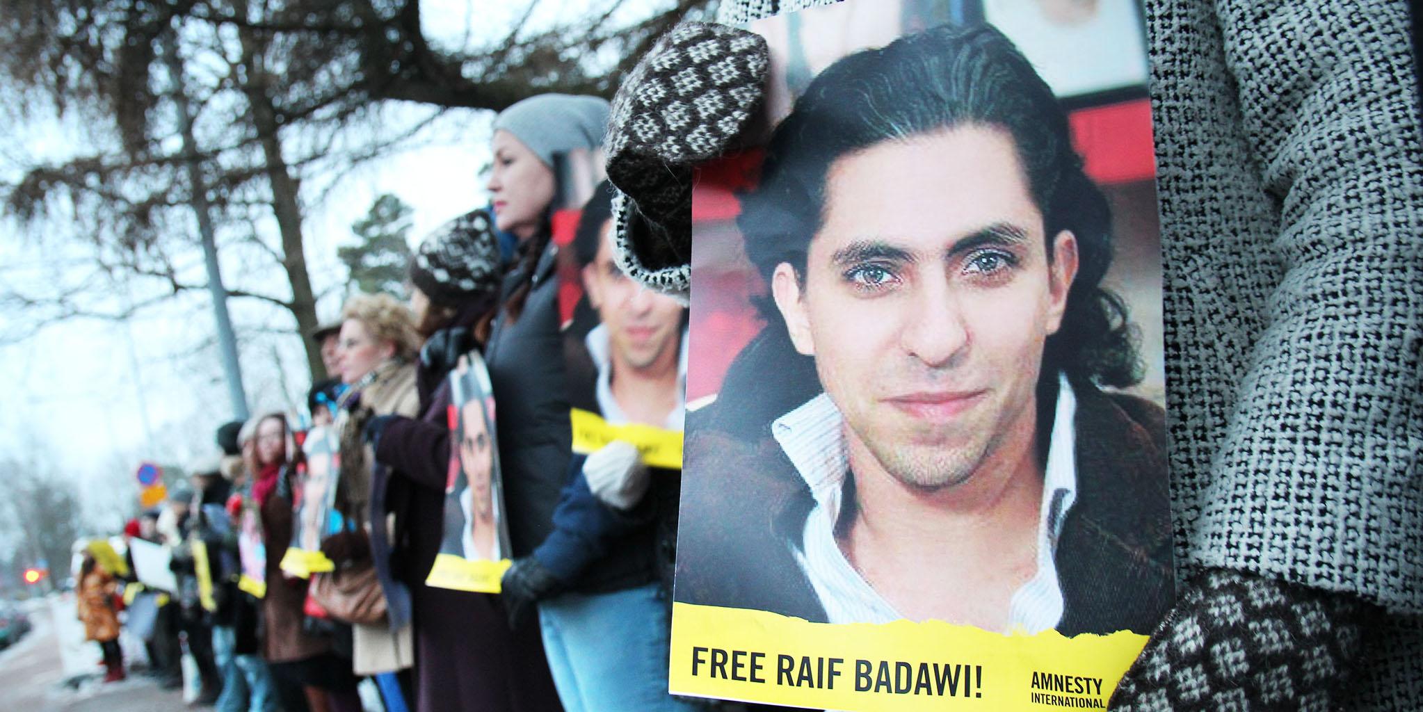 Protestors call for Raif Badawi's freedom.