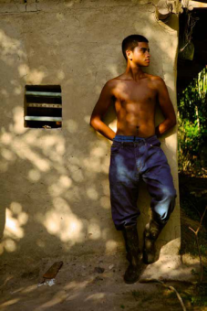 When Ciriaco Muñoz died, he left nothing more than a machete (now rusty) and a pair of work pants. Here, his son, Olvin Muñoz López is wearing his father's pants. Eventually, he will have to decide between leaving (like his older sister who lives in Tegucigalpa and works in a tortilla factory) or staying in the region and working on the oil palm plantations (possibly as an employee of one of the large landowners). He commented that neither option seems very promising.